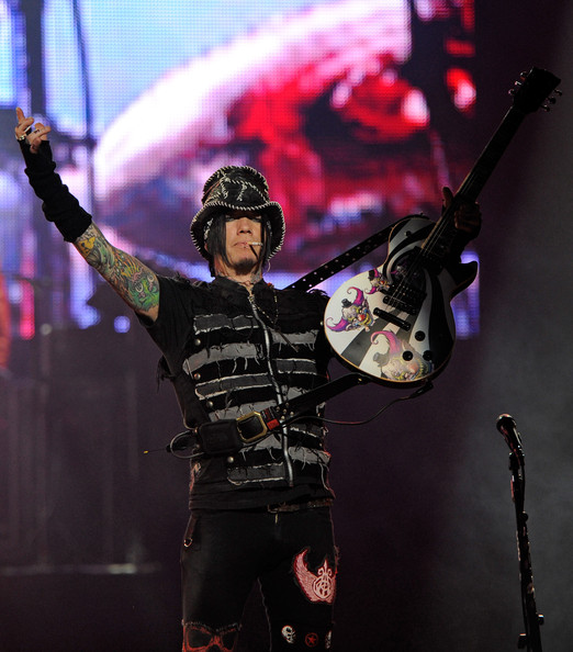 DJ Ashba playing at the concert of Guns N Roses