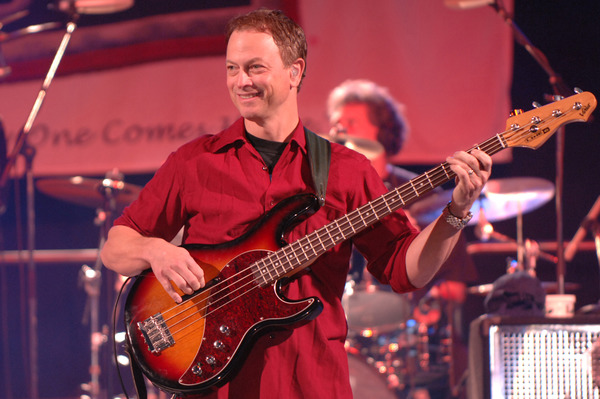 Gary Sinise playing bass