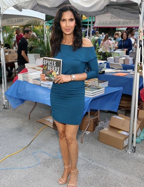 "Padma Lakshmi poses with her book ""The Encyclopedia of Spices and Herbs"""