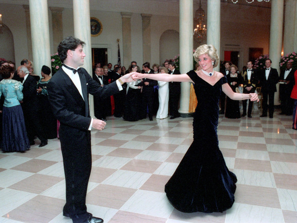 Princess Diana dances with John Travolta wearing a black dress