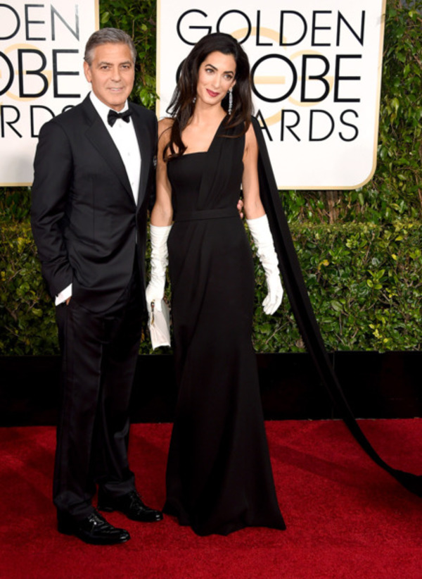 Amal Clooney with her husband George Clooney wearing black classy dress