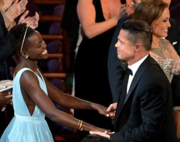 Lupita Nyong'o celebrates with Brad Pitt the success of their project