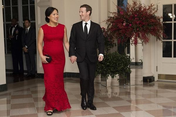 Pregnant Priscilla Chan and Mark Zuckerberg