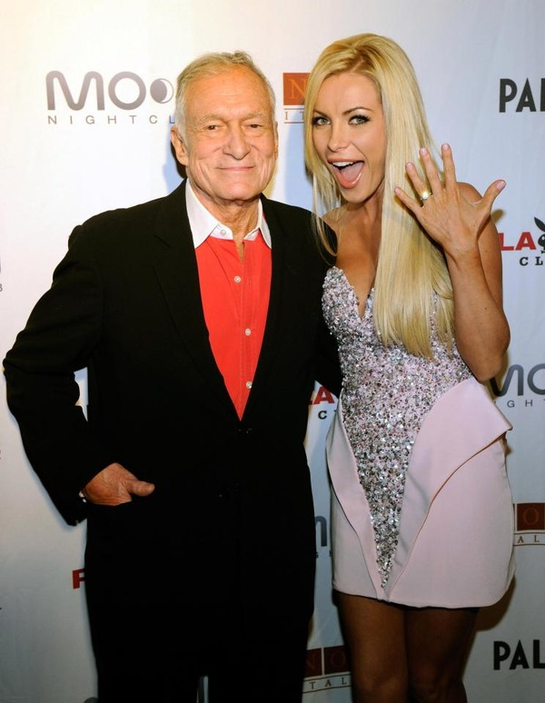 Crystal Hefner is posing with a ring near Hef