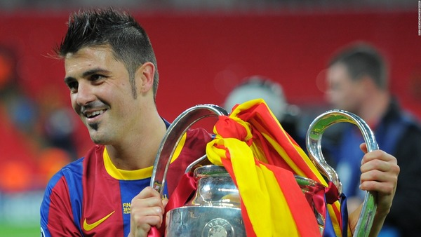David Villa with Champions League trophy