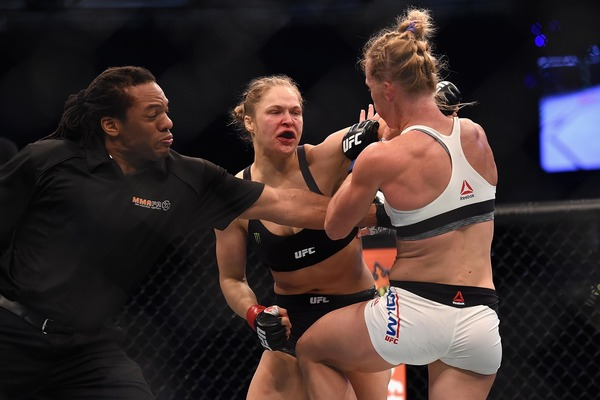 Herb Dean refs the match of Ronda Rousey and Holly Holm