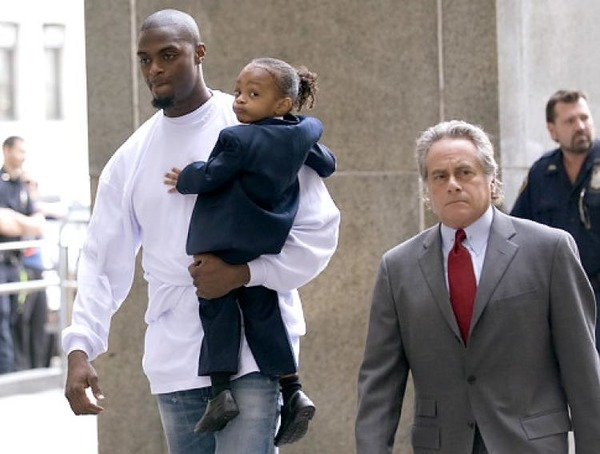 Plaxico Burress with his son and lawyer Benjamin Brafman