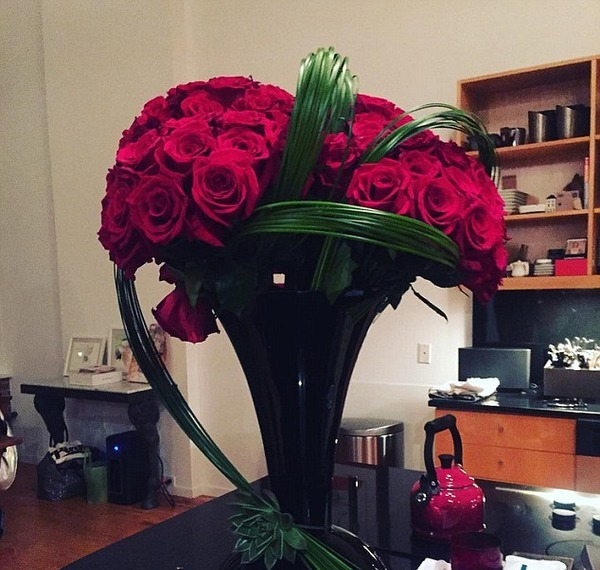 Behati Prinsloo shared in social media the photo of rose boquet Adam Levine had presented her