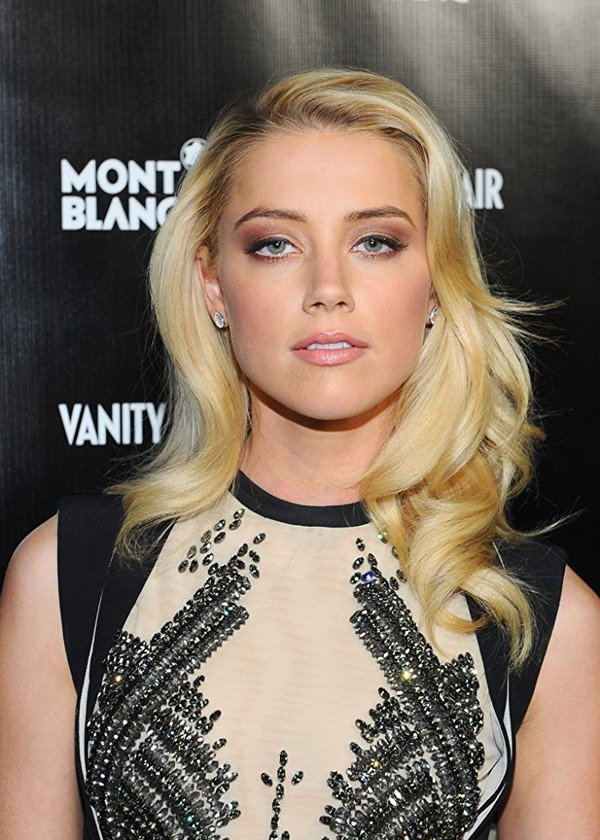 Amber Heard spent her divorce money for charity