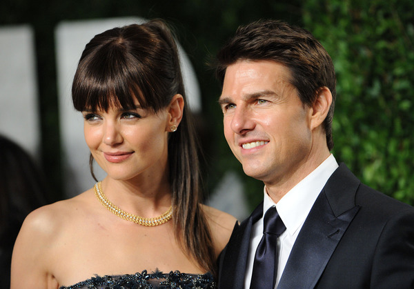 Tom Cruise and Katie Holmes at a party