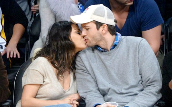 Ashton Kutcher kisses Mila Kunis