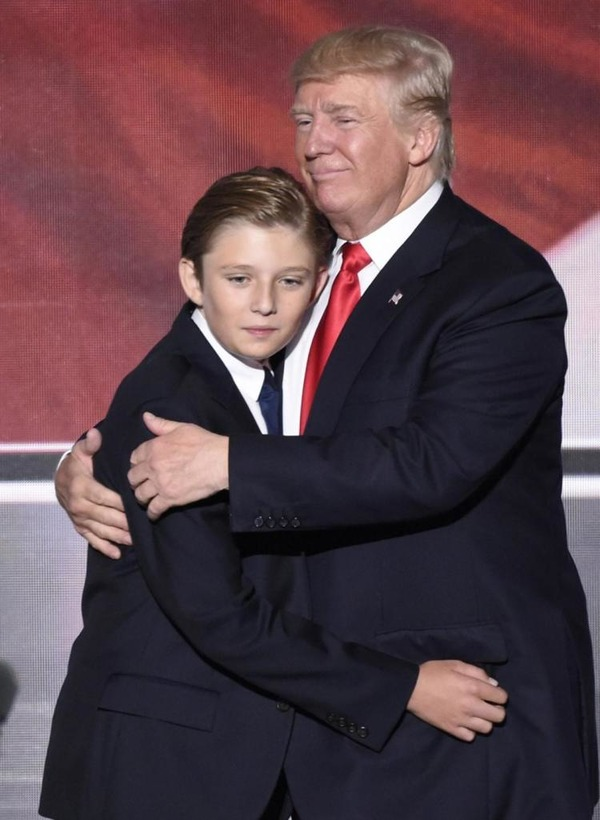 Barron Trump with his father