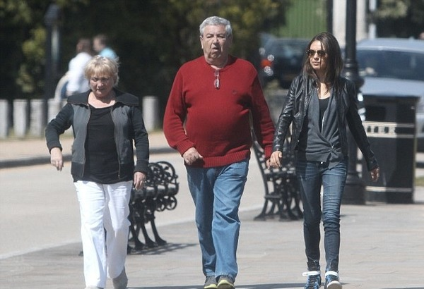 Mila Kunis with her parents
