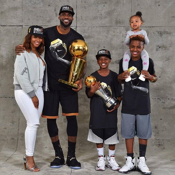 LeBron James Jr with his mother, father and siblings