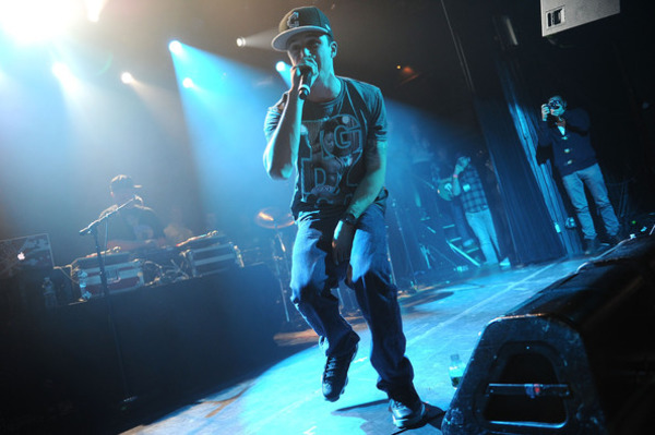 Chris Webby singing at a rock concert