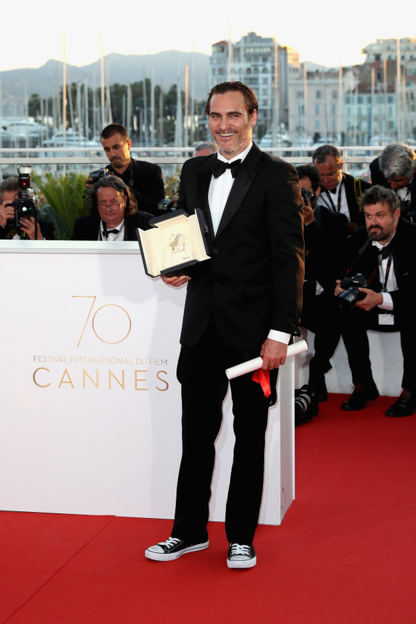 Joaquin Phoenix with Palme D'Or at Cannes Festival
